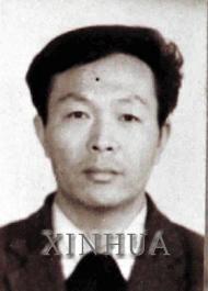 a.Wang Jindong antes da autoimolação