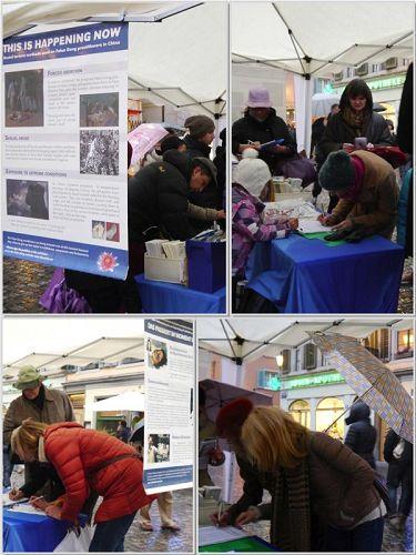 '二零一三年十一月二十三日,众多路人在雨中驻足签名制止中共活摘器官'