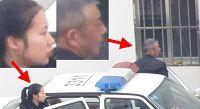 图2:到潍坊市洗脑班迫害法轮功的两个恶警(一男一女、一老一年轻)。这两个恶警从警车上下来,后面是洗脑班牢房的窗户。然后这两个恶警和洗脑班的恶人有说有笑的进入迫害法轮功学员的牢房。