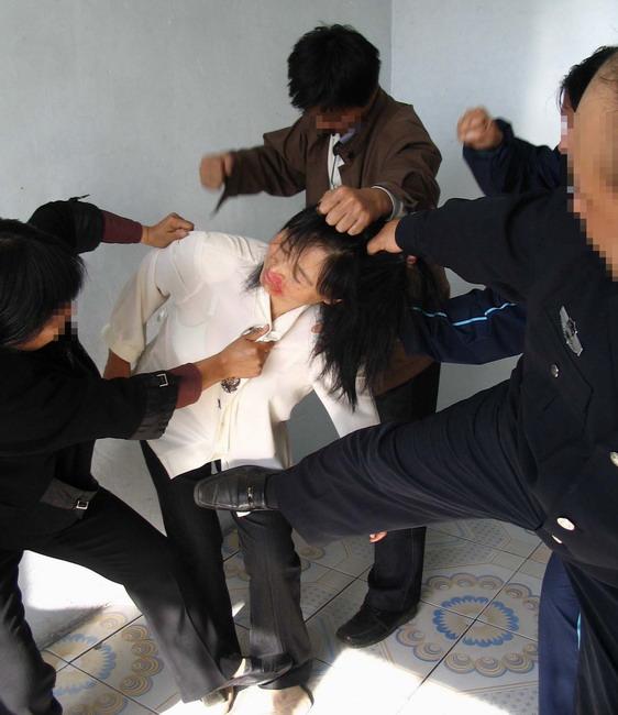 2013-9-24-minghui-torture-beating.jpg