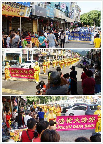 法轮功学员来到文冬举行第二场的中秋游行,引起民众追随观看。