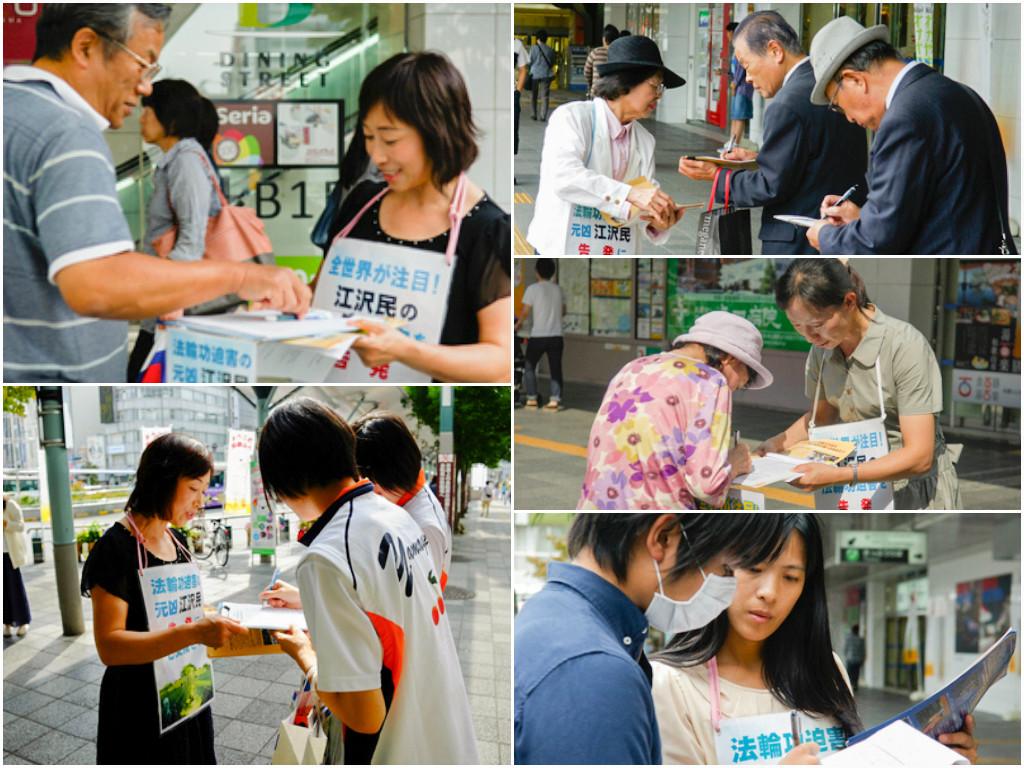 9月、大阪で「江沢民告訴」に向けた署名にサインする市民(明慧ネット)