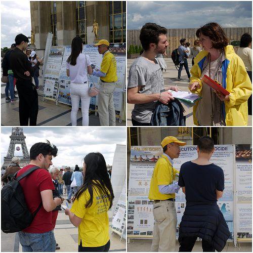 图4:许多游客认真阅读真相展板,并与法轮功学员攀谈,进一步了解法轮功。
