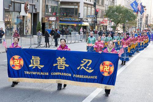 '图1~7:二零一七年十一月十一日,纽约的法轮功学员参加了美国传统的老兵节游行,受到主办方和观众的赞叹。'