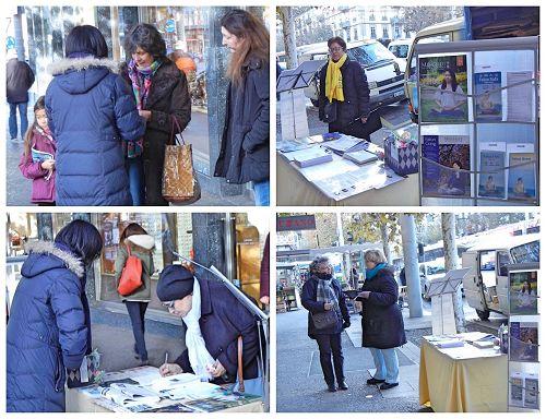 '二零一七年三月二十二日,瑞士法轮功学员在内瓦市的一个集市上设立了讲真相摊位,向民众传播法轮功真相。'