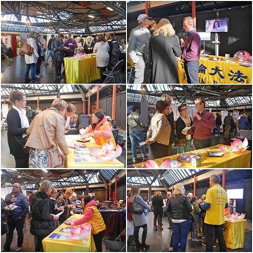 '图1:二零一七年十一月五日,比利时的法轮功学员参加了在哈瑟尔特市召开的健康博览会,许多民众到展位了解法轮功。'