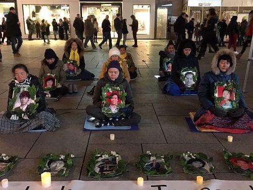 图1-2:二零一七年十二月九日,法兰克福的法轮功学员举办烛光守夜,悼念在中国被中共迫害致死的法轮功学员。