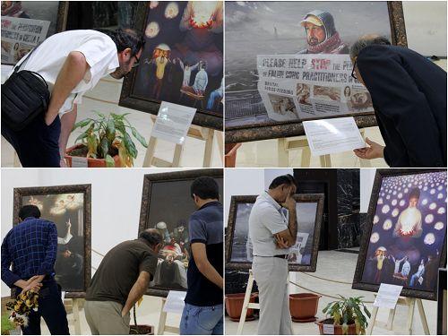 图2:这次展览吸引了超过四千多名来自附近城市的游客和居民,人们在仔细的阅读画展介绍,了解真相