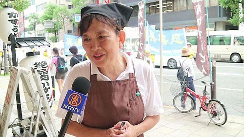 '图6:一位京都店员谴责活摘暴行'