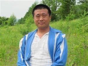 '王新春遗照'
