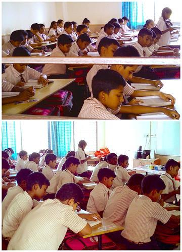 图3:骄狄英语中学高年级的学生在各自的课堂里读《转法轮》。