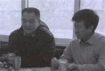 左为唐国防、右为程东晓(南京下关区610主任)