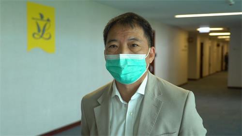 '图9:民主党主席、立法会议员胡志伟'