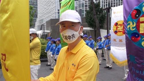 """'图20:法轮功学员张宰健说:他说,""""希望在中国的学员能够找回自由的修炼环境。""""'"""