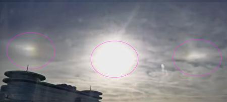 """2020年12月29日,北京市上空出现""""三个太阳""""的""""幻日""""景象(视频截图)。"""