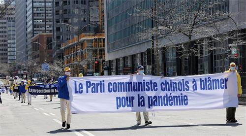 '图1~11:加拿大魁北克省部份法轮功学员汇聚蒙特利尔,举行纪念四·二五和平上访二十二周年大游行活动'