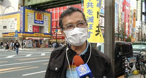 """'图8:一位路人表示:""""(中共)活摘器官太残酷了,必须要停止""""'"""
